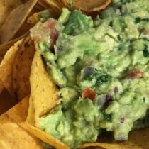 Guacamole atop tortilla chips