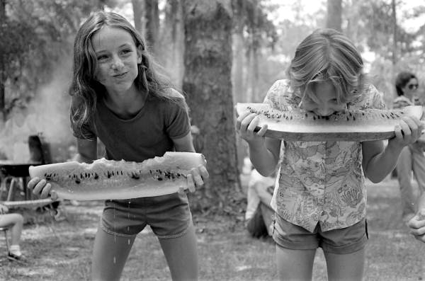 Girls competing in a watermelon eating contest on July 4th: White Springs, Florida | EvinOK.com