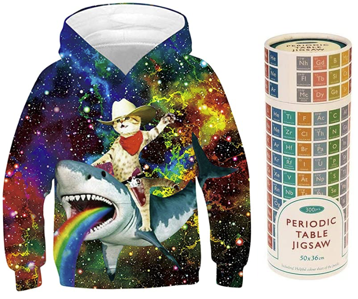 Hooded sweatshirt with cat riding a rainbow-vomiting shark beside a periodic table of elements puzzle in a tube-shaped package.