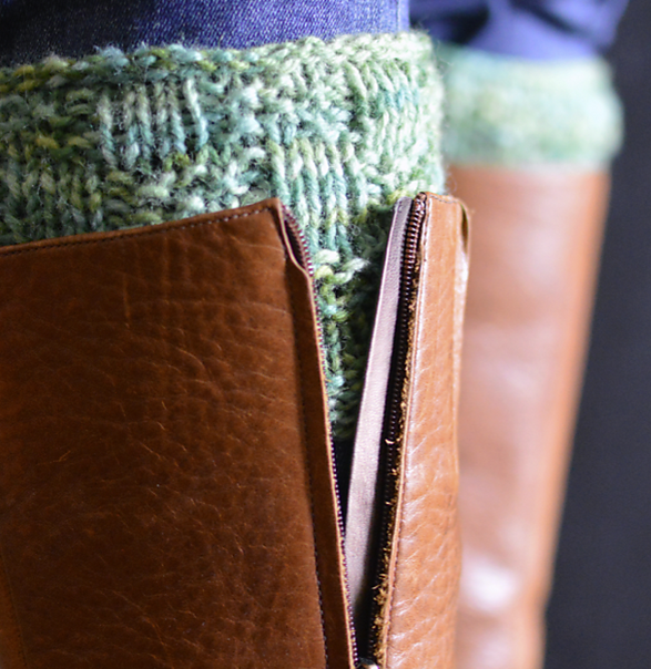 Knit boot toppers peeking out from top of brown boots.